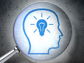 Education concept: Head With Lightbulb with optical glass on di — Foto de Stock