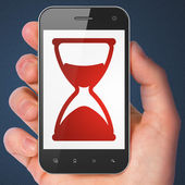 Timeline concept: Hourglass on smartphone — Stockfoto