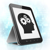 Advertising concept: Head With Gears on tablet pc computer — Stock Photo
