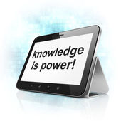 Education concept: Knowledge Is power! on tablet pc computer — Stockfoto
