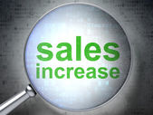 Marketing concept: Sales Increase with optical glass — Stock Photo