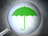 Safety concept: Umbrella with optical glass on digital backgrou — Stock Photo