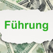 Finance concept: Fuhrung(german) on Money background — Foto Stock #32649927