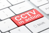Security concept: CCTV In action on computer keyboard background — Stockfoto