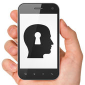 Advertising concept: Head With Keyhole on smartphone — Stockfoto