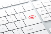 Protection concept: Eye on computer keyboard background — Stock Photo
