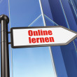 Education concept: Online Lernen(german) on Building background — Stock Photo #32652823