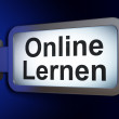 Education concept: Online Lernen(german) on billboard background — Stock Photo #32653443