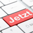 Time concept: Jetzt(german) on computer keyboard background — Stockfoto