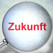 Time concept: Zukunft(german) with optical glass on digital back — Стоковая фотография