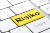 Finance concept: Risiko(german) on computer keyboard background — Stockfoto