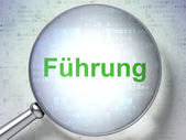 Finance concept: Fuhrung(german) with optical glass on digital b — Foto de Stock