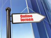 Education concept: Online Lernen(german) on Building background — Stok fotoğraf