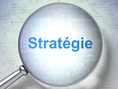 Finance concept: Strategie(french) with optical glass on digital — Foto de Stock