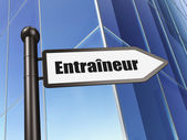 Education concept: Entraineur(french) on Building background — Stock Photo
