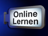 Education concept: Online Lernen(german) on billboard background — 图库照片