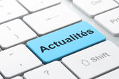 News concept: Actualites(french) on computer keyboard background — Stock Photo