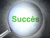 Business concept: Succes(french) with optical glass on digital b — Foto de Stock