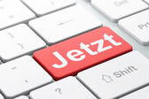 Time concept: Jetzt(german) on computer keyboard background — Stok fotoğraf