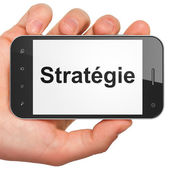 Finance concept: Strategie(french) on smartphone — Foto de Stock