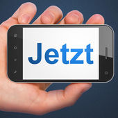 Time concept: Jetzt(german) on smartphone — 图库照片