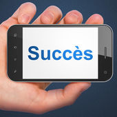 Business concept: Succes(french) on smartphone — Stock Photo