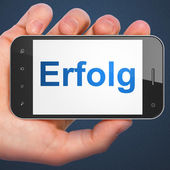 Business concept: Erfolg(german) on smartphone — Stock Photo