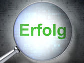 Finance concept: Erfolg(german) with optical glass on digital ba — Stock Photo