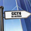 Security concept: CCTV In action on Building background — Stock Photo #33140203