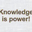 Education concept: Knowledge Is power! on fabric texture backgro — Stock Photo