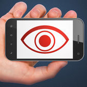 Protection concept: Eye on smartphone — Stok fotoğraf