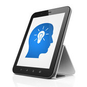 Advertising concept: Head With Light Bulb on tablet pc computer — Stock Photo
