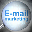 Marketing concept: E-mail Marketing with optical glass — Stockfoto #33293267
