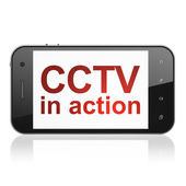 Safety concept: CCTV In action on smartphone — Stock Photo