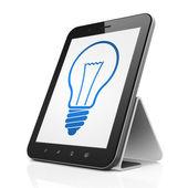 Finance concept: Light Bulb on tablet pc computer — Zdjęcie stockowe