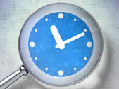 Time concept: Clock with optical glass on digital background — ストック写真