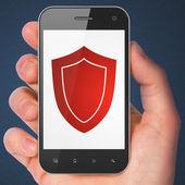 Privacy concept: Shield on smartphone — Stok fotoğraf