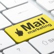 Advertising concept: Mouse Cursor and Mail Marketing on computer — Stock Photo #33457245