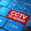 Privacy concept: CCTV In action on computer keyboard background — Stock Photo #33458041