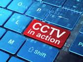 Privacy concept: CCTV In action on computer keyboard background — Stock Photo