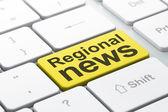 Concepto de noticias: noticias regionales sobre fondo de teclado de computadora — Foto de Stock