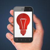 Finance concept: Light Bulb on smartphone — Foto Stock