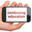 Stock Photo: Education concept: Continuing Education on smartphone