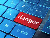 Safety concept: Danger on computer keyboard background — Stock Photo