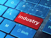 Finance concept: Industry on computer keyboard background — Stock Photo