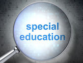Education concept: Special Education with optical glass — Stock Photo