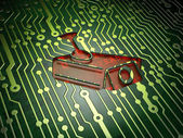 Protection concept: Cctv Camera on circuit board background — Stock Photo