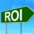 Finance concept: ROI on road sign background — Zdjęcie stockowe #34092969