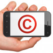 Law concept: Copyright on smartphone — Stock Photo #34093755