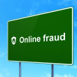 Protection concept: Online Fraud and Shield on road sign — Foto Stock #34097229